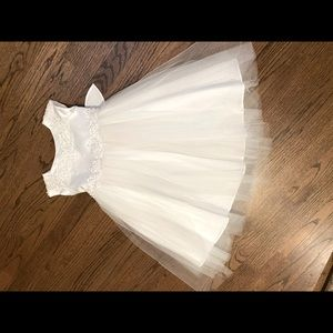 White formal dress with embroidery sized  2 and 4